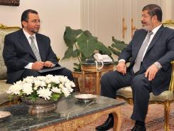 Egyptian President Mohamed Morsi, right, meets July 25 with the newly nominated Prime Minister Hisham Qandil at the Egyptian Presidential Palace in Cairo.