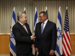 Israeli Defence Minister Ehud Barak, left, stands with U.S. Defence Secretary Leon Panetta at the start of their meeting on Wednesday in Tel Aviv, Israel.