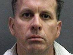 This booking photo shows Rainer Reinscheid, 48, a professor at the University of California, Irvine, who was arrested July 24 and charged with numerous felony arson charges.