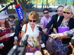 Mary Ellen Hansen, the aunt of Ashley Moser, who was shot during the screening of 'The Dark Knight Rises,' speaks to the media outside the Arapahoe County Courthouse following James Holmes' arraignment on July 30.