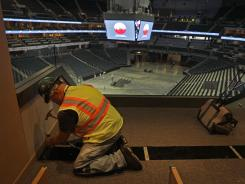 Steve Law works on a luxury box at Time Warner Cable Arena — where the majority of the Democratic National Convention will be held — in Charlotte on July 16.