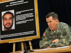 Brig. Gen. Kevin J. Bergner speaks during a July 2007 press conference near a poster of a senior Lebanese Hezbollah operative Ali Mussa Daqduq in Baghdad.