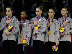 Gold medalists: From left, American gymnasts Jordyn Wieber, Gabby Douglas, McKayla Maroney, Aly Raisman and Kyla Ross at the medal ceremony in London on Tuesday night.