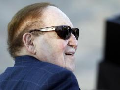 American businessman Sheldon Adelson, who has said he will donate millions to Republican presidential candidate and former Massachusetts Gov. Mitt Romney's campaign, is seated before Romney delivers a speech in Jerusalem on July 29.