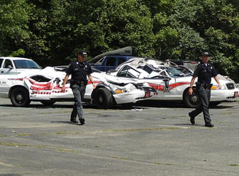Vermont farmer in tractor crushes seven police cars  Farmer smashes 7 police cruisers with tractor Q1209105 x large