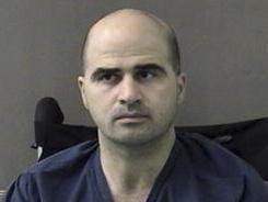 This photo released by the Bell County Sheriff's Department shows U.S. Major Nidal Hasan at the Bell County Jail in Belton, Texas, on April 9, 2010.