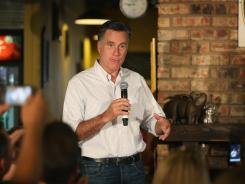 Republican presidential candidate Mitt Romney speaks to supporters during a campaign event Saturday at Stepto's BBQ Shack in Evansville, Ind.