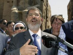 Egyptian President Mohammed Morsi, shown here Friday in Luxor, called for an emergency meeting with the military after the border attack.