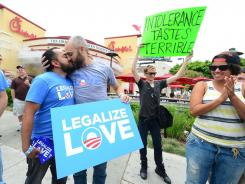'Intolerance tastes terrible': Gay-rights demonstrators at a Chick-fil-A in Hollywood on Friday.