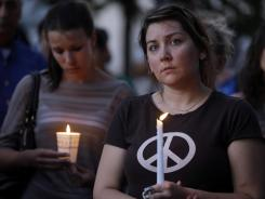 Mourners take part in a candlelight vigil for the victims of the Sikh Temple of Wisconsin shooting in Milwaukee.