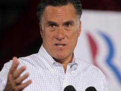 Mitt Romney campaigns Friday at McCandless Trucking in North Las Vegas.