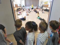 First-graders look in on a PE class during a tour of their new school in Joplin, Mo.