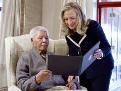 U.S. Secretary of State Hillary Rodham Clinton meets with Nelson Mandela, 94, former president of South Africa, at his home in Qunu, South Africa, Monday.