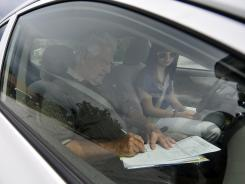 Jim Collins of the Auto-Safe Driving School works with Lori North, 15, of Greenville, S.C., on her final road test on July 20.