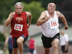 Art Turock, 62, left, of Kirkland, Wash., powers to the finish line July 28 in the men's 50-meter dash at the Washington State Senior Games track and field competition in Tumwater, Wash.