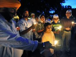 Members of the Sikh Society of Northeast Florida attend a candlelight vigil for the victims of the Sikh Temple of Wisconsin shooting.