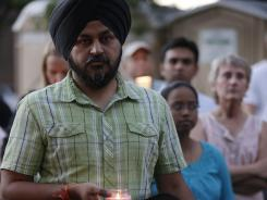 Mourners take part in a candlelight vigil for the victims of Sunday's mass shooting at the Sikh Temple of Wisconsin near Milwaukee.
