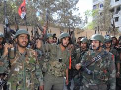 Syrian army troops are deployed on Saturday in Damascus.