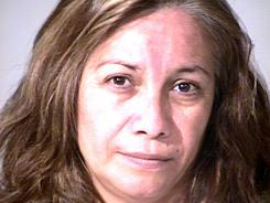 In this photo provided by the Garden Grove, Calif., police, Grisel Ramirez, 48, is seen in custody on Monday.