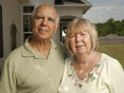 Ralph and Dorothy &quot;Dottie&quot; Serran stand outside of their home in the Sun City Carolina Lakes retirement community in Fort Mill, S.C. The couple moved from Long Island in 2007 to be near their children and grandchildren and were happy to find a lower cost of living and lower taxes.
