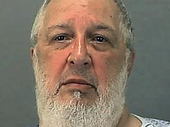 This photo provided by the Summit County Sheriff Department shows John Wise, 66, who is suspected of the mercy killing of his wife, shot at her bedside in the ICU unit of Akron General Medical Center Saturday.