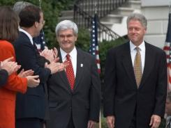 President Clinton and House Speaker Newt Gingrich, R-Ga., arrive at the White House on Aug. 5, 1997, where Clinton signed the balanced budget bill.