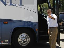 Mitt Romney boards a campaign bus in Salem, Va., on June 26.