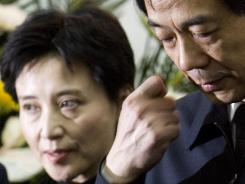 Bo Xilai, right, then China's Minister of Commerce, and his wife, Gu Kailai, attend a memorial ceremony for Bo's father in Beijing.
