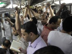 An Egyptian man reads the Quran at an underground metro after a massive power outage hit large parts of Cairo on Thursday.