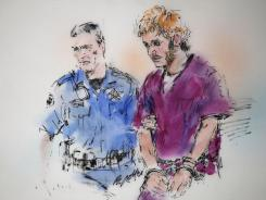 James Holmes, right, has been charged with murdering 12 people.