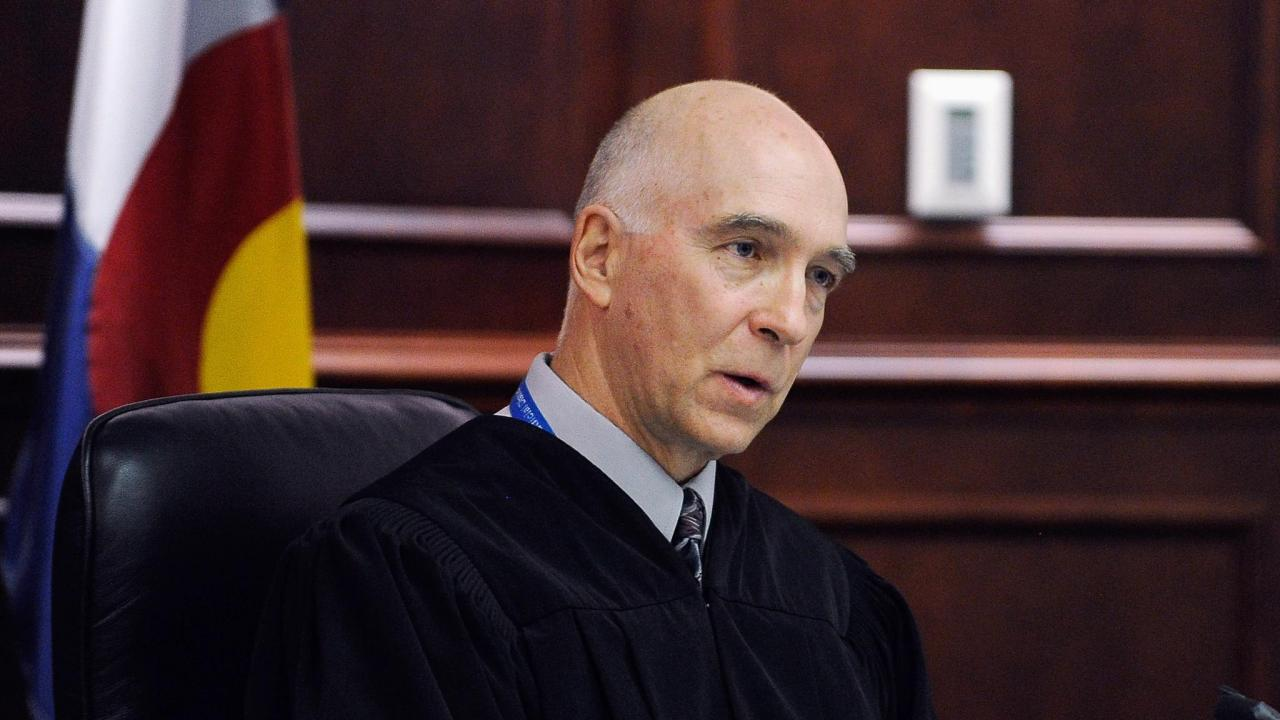 Chief Judge William B. Sylvester presides over accused movie theater shooter James Holmes' July 23 court appearance in Centennial, Colorado.