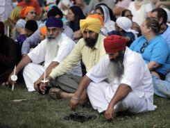 Mourners and supporters of the Sikh Temple of Wisconsin attend a candle light vigil Tuesday in Oak Creek, Wis.