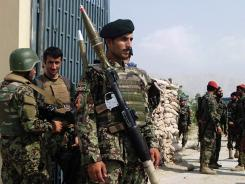 Afghan National Army soldiers stand guard Thursday in Laghman province after an Afghan soldier turned his weapon on NATO allies. The next day a similar attack left three U.S. Marines dead.