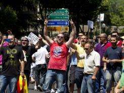 Taxi drivers protest in front of Spain's Economy Ministry during a demonstration in Madrid July 27.