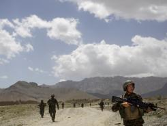 Afghan soldiers patrol outside the village of Noor Khiel, in Logar province, east Afghanistan.