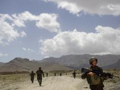 Afghan National Army soldiers patrol outside the village of Noor Khiel, in Logar province, east Afghanistan.