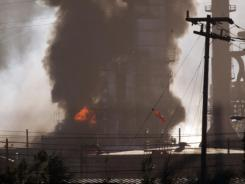 Smoke and flame billow from a crude oil unit at the Chevron refinery in Richmond, Calif., on Aug. 6.