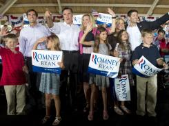 The Romney and Ryan families greet supporters Saturday in Manassas, Va.
