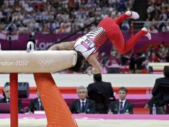 Landing or falling: Japanese gymnast Kohei Uchimura's controversial finish on the pommel July 30. The Japanese team officials challenged the judges' call, with cash.