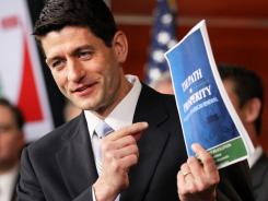House Budget Committee Chairman Paul Ryan shows his fiscal proposal.