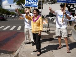U.S. Rep. Mazie Hirono, D-Hawaii, does some last-minute campaigning Saturday in Honolulu.