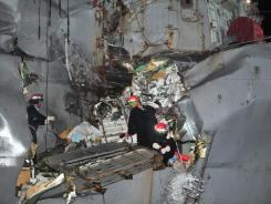 The U.S. Navy's guided-missile destroyer is seen damaged after it collided with a Japanese-owned oil tanker just outside the Strait of Hormuz on, Sunday.