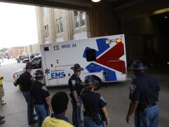 An ambulance leaves the Indiana State Fair Coliseum after a stagecoach overturned at the fair on Sunday in Indianapolis.