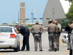 Texas State troopers and Brazos Valley lawmen work the scene of a shooting near the campus of Texas A&M university Monday.