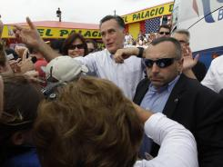 Mitt Romney greets supporters at a campaign event at El Palacio de los Jugos on Monday in Miami.