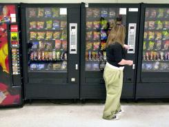 Laws governing the sale of junk food in public schools may help curb childhood obesity, according to a new study.