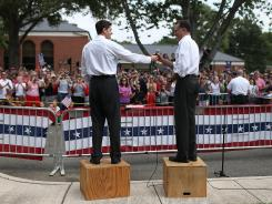 Campaign rally: Paul Ryan hands the microphone to Mitt Romney on Saturday in Ashland, Va.