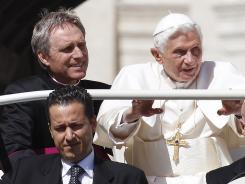 Pope Benedict XVI arrives in St. Peter's Square at the Vatican as his butler Paolo Gabriele, bottom, and his personal secretary, Georg Gaenswein, sit in the car with him.