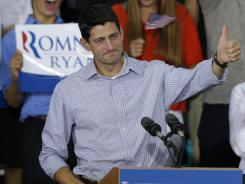 Wisconsin Rep. Paul Ryan, Mitt Romney's running mate, acknowledges the crowd at a rally in Waukesha, Wis., on Sunday.