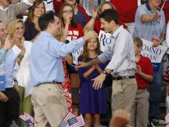 Wisconsin Gov. Scott Walker greets Paul Ryan on Sunday in Waukesha.